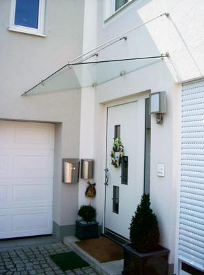 vordach aus glas und edelstahl vom schreiner f r holz. Black Bedroom Furniture Sets. Home Design Ideas